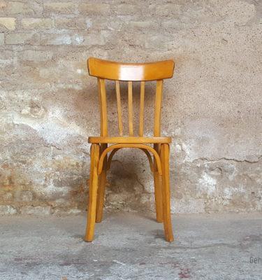 Chaises bistrot vintage en bois clair, dossier à barreaux